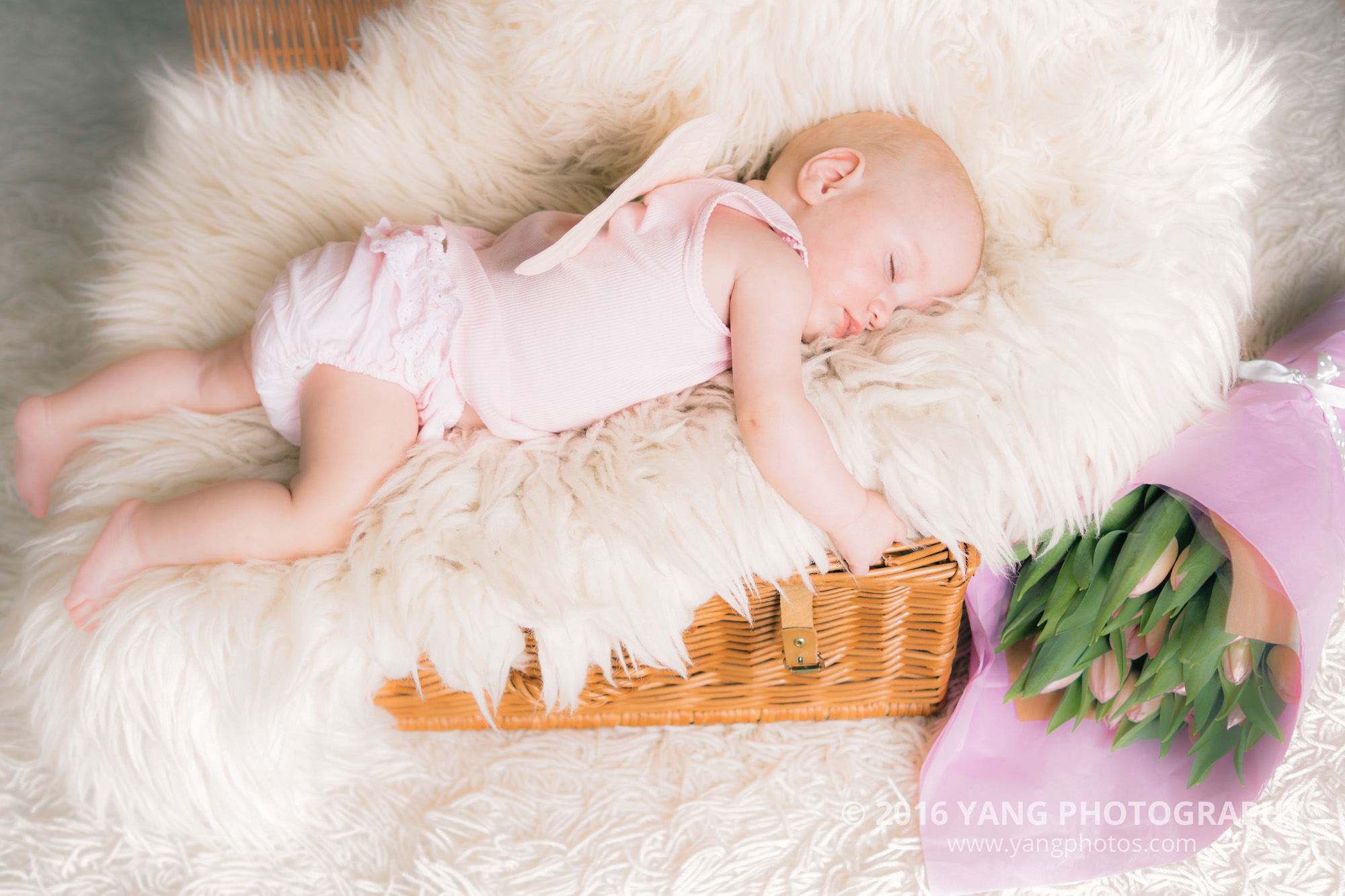 sleeping baby with tulips